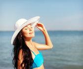 Girl in bikini standing on the beach — Stock Photo