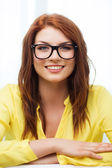 Smiling teenage girl in eyeglasses at home — Stockfoto