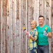 Smiling couple with paintbrush — Stock Photo #45168571