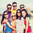 Group of friends having fun on the beach — Stock Photo