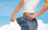 Close up of female showing big jeans — Foto Stock