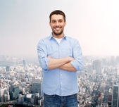 Smiling man with crossed arms — Stock Photo