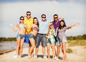 Group of friends having fun on the beach — Foto Stock