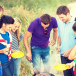 Group of friends having picnic on the beach — Stock Photo #45171137