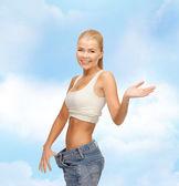 Sportif kadın gösteren büyük pantolon — Stok fotoğraf