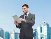 Smiling businessman with tablet pc computer — Stock Photo