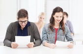 Two teenagers looking at test or exam results — Stock Photo