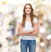 Smiling teenager in blank white t-shirt — Stock Photo