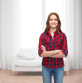 Smiling young woman in casual clothes — Stockfoto