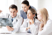 Group of doctors looking at x-ray — Stock Photo