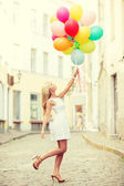 Woman with colorful balloons — Stockfoto
