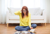 Stressed student girl reading books at home — Stock Photo