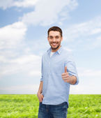 Smiling man showing thumbs up — Stock Photo