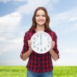Young woman in casual clothes with wall clock — Foto de Stock   #45541123