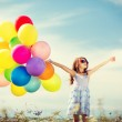Happy girl with colorful balloons — Stock Photo #45541603