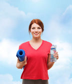 Smiling girl with bottle of water after exercising — Foto Stock