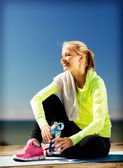 Woman resting after doing sports outdoors — Stock Photo