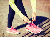 Runner woman lacing trainers shoes — Stock Photo