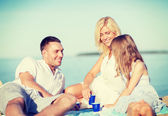 Happy family having a picnic — Stock Photo