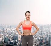 Smiling teenage girl in sportswear — Stock Photo