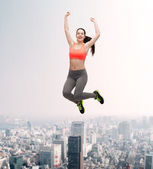 Sporty teenage girl jumping in sportswear — Stok fotoğraf