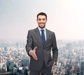 Businessman with open hand ready for handshake — Stock Photo