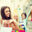 Beautiful woman with shopping bags in the ctiy — Stock Photo #45673145