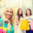 Beautiful woman with shopping bags in the ctiy — Stock Photo #45673253