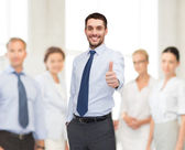 Handsome businessman with crossed arms — Stock Photo