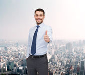 Handsome businessman showing thumbs up — Stock Photo