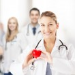 Female doctor with heart — Stock Photo #45945735