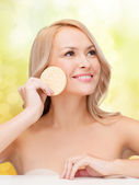 Beautiful woman with sponge — Stock Photo
