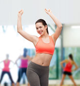 Smiling teenage girl in sportswear dancing — Stock Photo