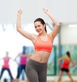 Smiling teenage girl in sportswear dancing — Стоковое фото