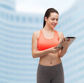 Sporty woman with tablet pc computer — Foto de Stock