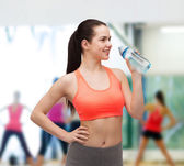 Sporty woman with water bottle — Stock Photo