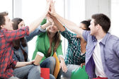 Students giving high five at school — Stock Photo