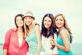 Group of girls chilling on the beach — Stock Photo