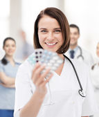 Doctor with blister packs of pills — Stock Photo
