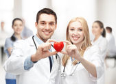 Cardiologists with heart — Stock Photo