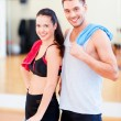 Two smiling people in the gym — Stock Photo #45999889