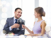 Couple with main course and red wine at restaurant — Stock Photo