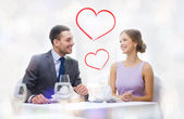 Smiling couple looking at each other at restaurant — Stockfoto