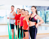 Group of people working out with rubber bands — Stock Photo