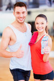 Two smiling people in the gym — Stock Photo