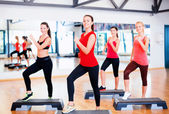 Group of smiling people doing aerobics — Foto de Stock