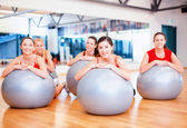 Group of people working out in pilates class — Foto de Stock