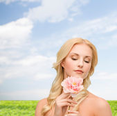 Lovely woman with peony flower — Stock Photo