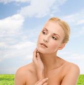 Beautiful woman touching her face skin — Stock Photo
