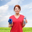 Smiling girl with bottle of water after exercising — Stock Photo #46600953